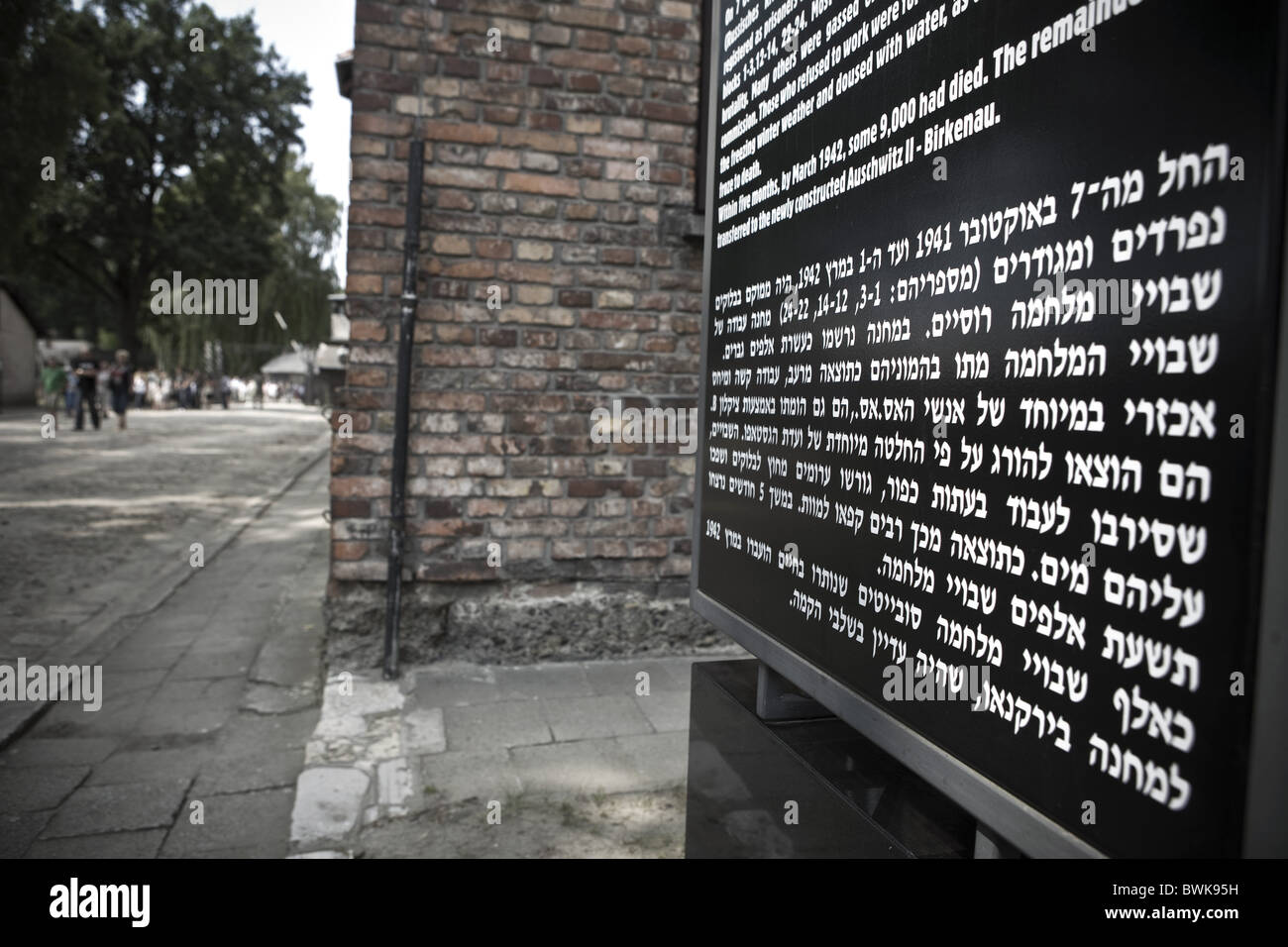 Information sign in Polish, English and Hebrew, Auschwitz Concentration Camp, Oswiecim, Poland, Europe - Stock Image