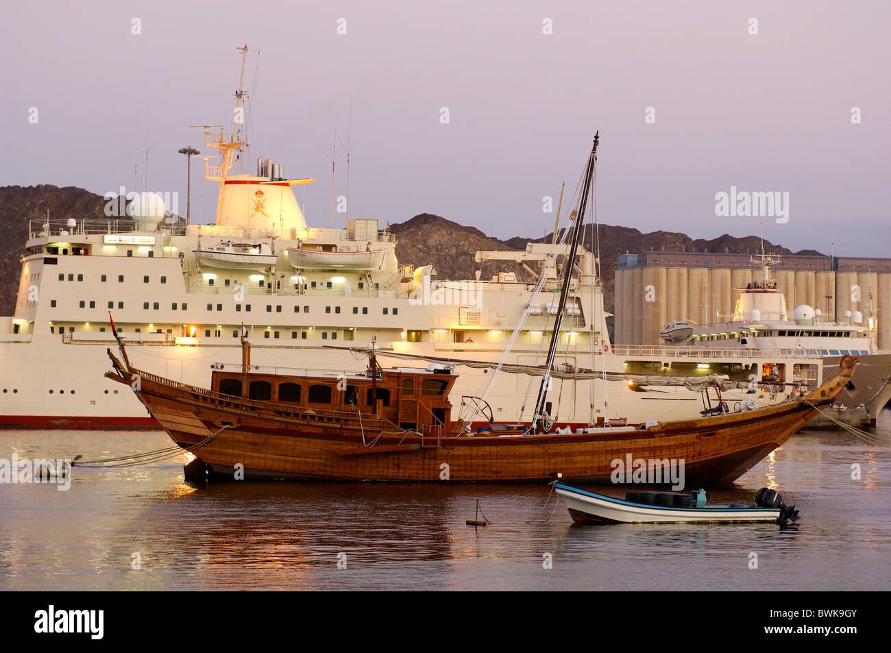 harbor port ship ships boats mood sea coast dusk twilight Muttrah courage yard Maskat Muscat Oman Arabi - Stock Image