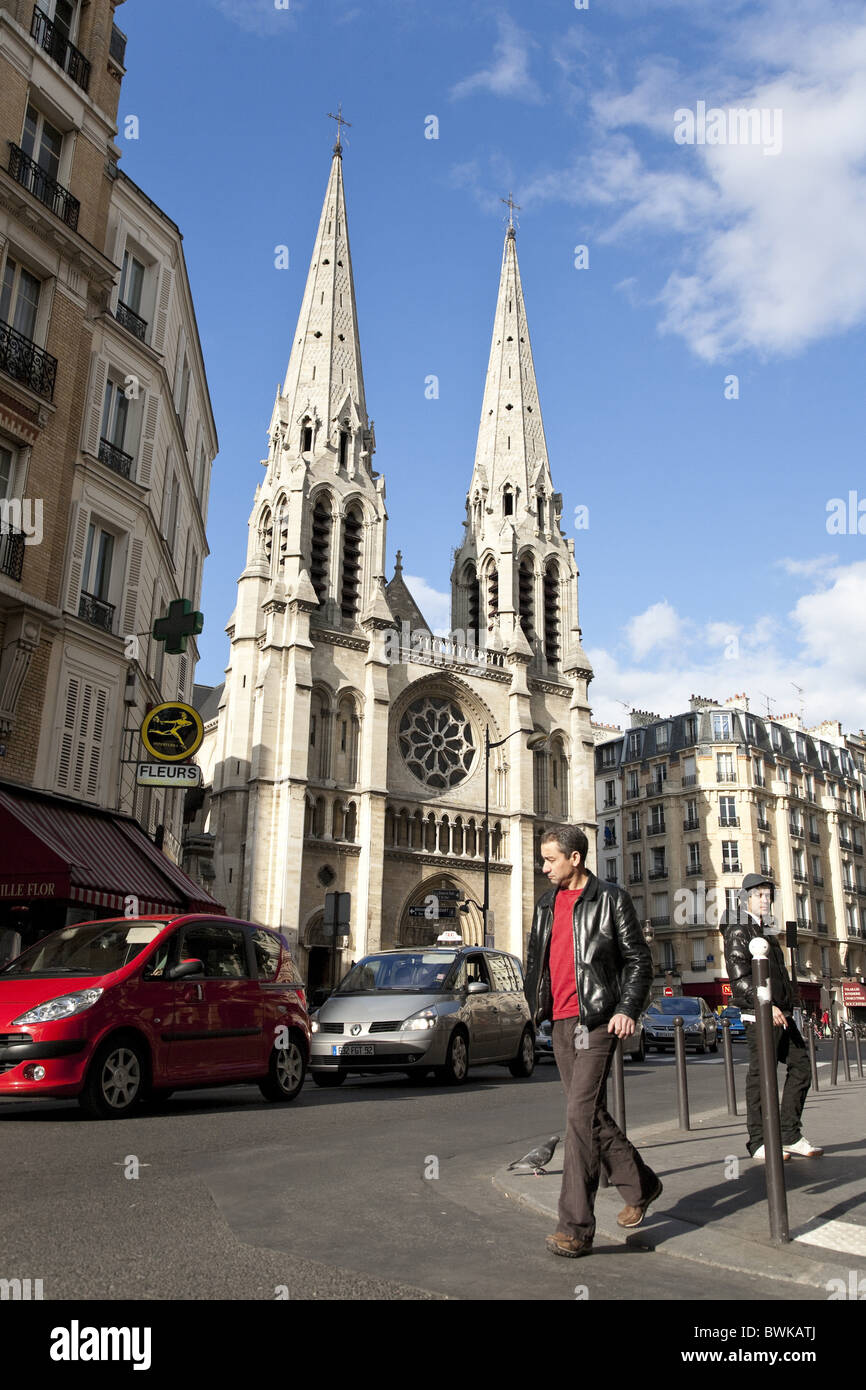 People and church in Belleville District, Paris, France, Europe - Stock Image