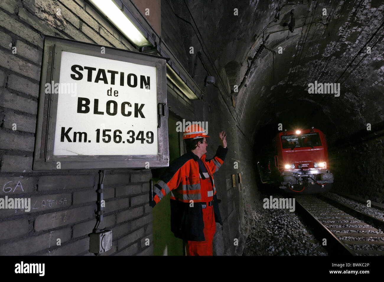 man office worker Swiss Federal Railways workers notice board sign shield Simplon Brig traveling transport - Stock Image
