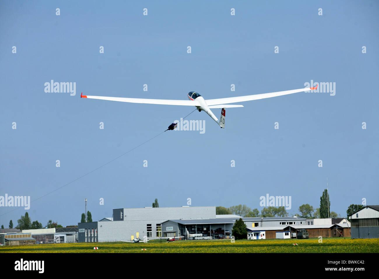 flight gliding flying airfield Altenrhein start air sail plane sailplane glider airplane Switzerland Europ - Stock Image