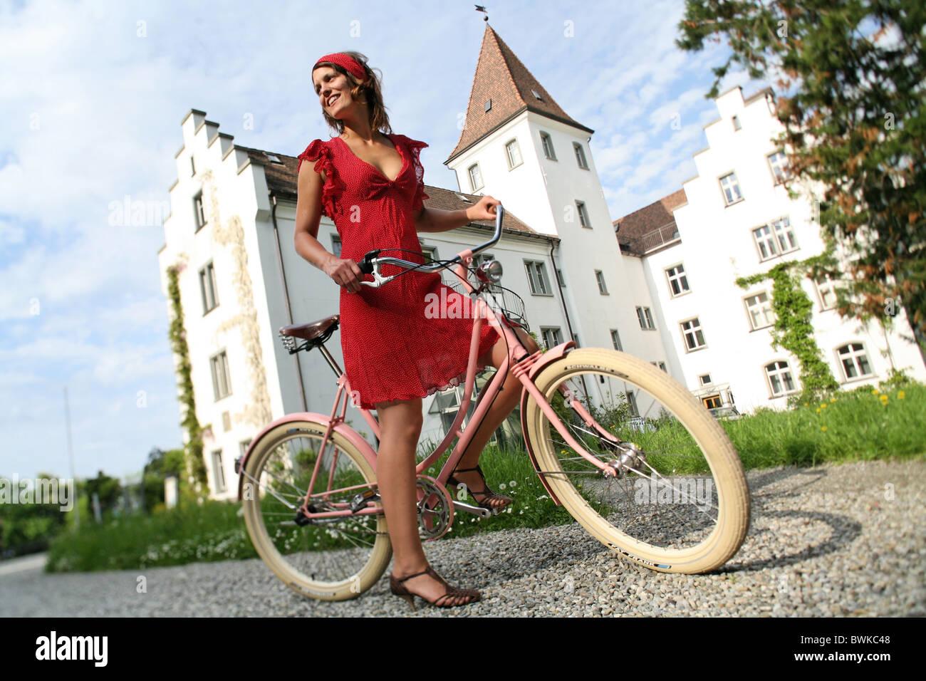 Retro bike Outside woman Laughing laughter puddles biking bicycle bike biking bicycle - Stock Image