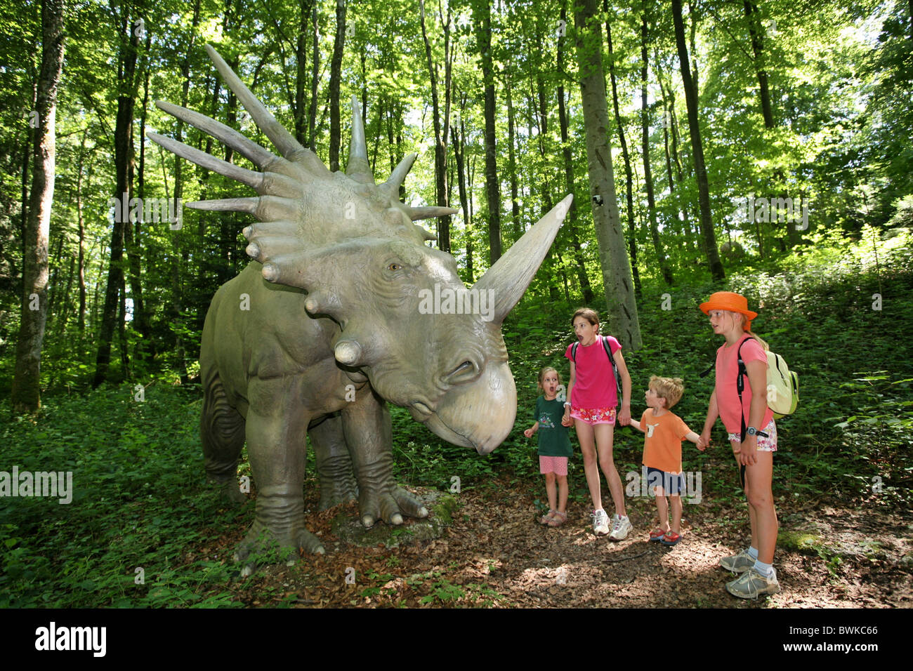 family group children dinosaurs Prehistorical park Reclere Canton Jura Switzerland Europe excursion experie - Stock Image
