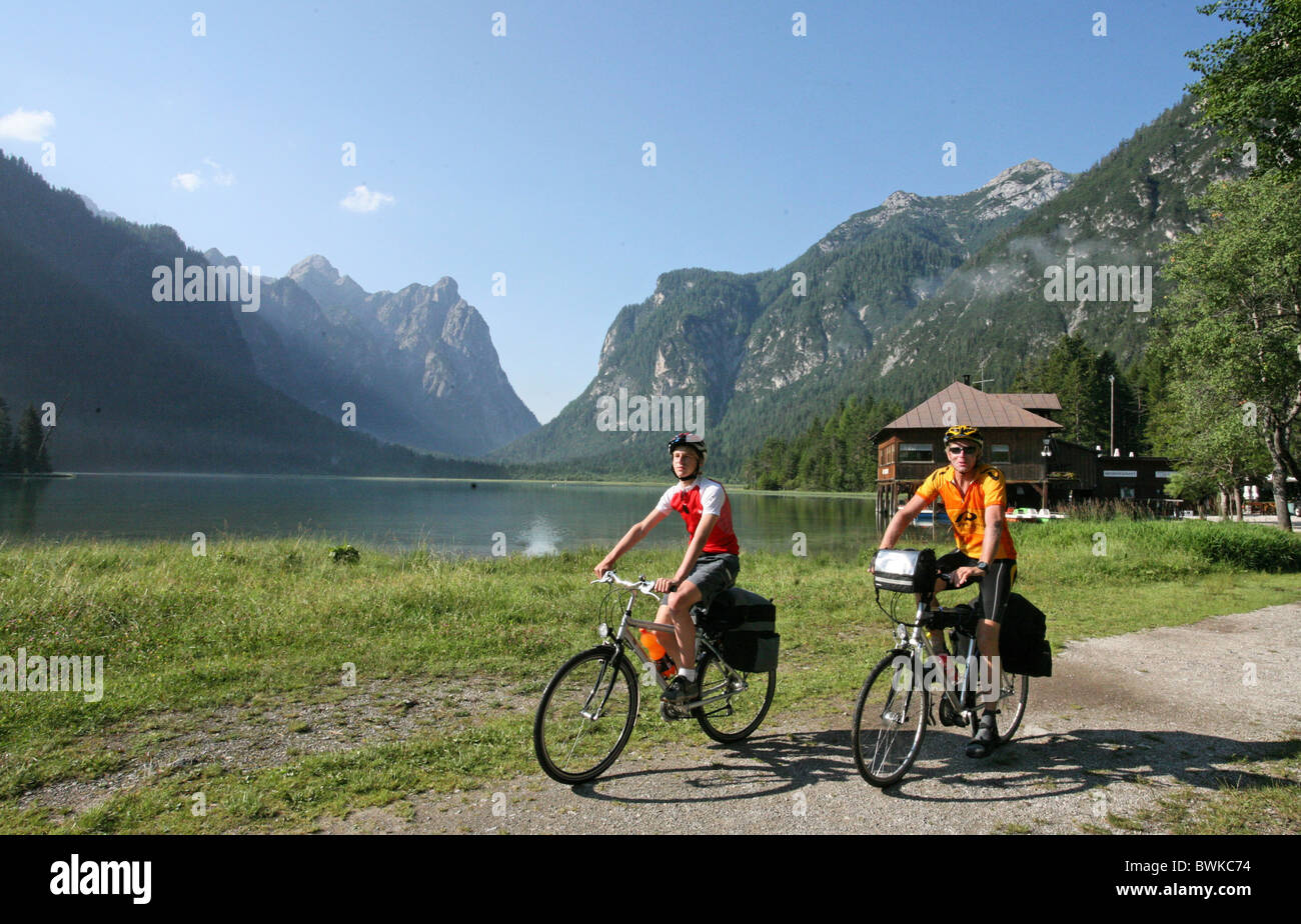 Two bikers persons biking excursion bicycles bikes biking bicycle bike biking bicycle riding a bike cyclis - Stock Image