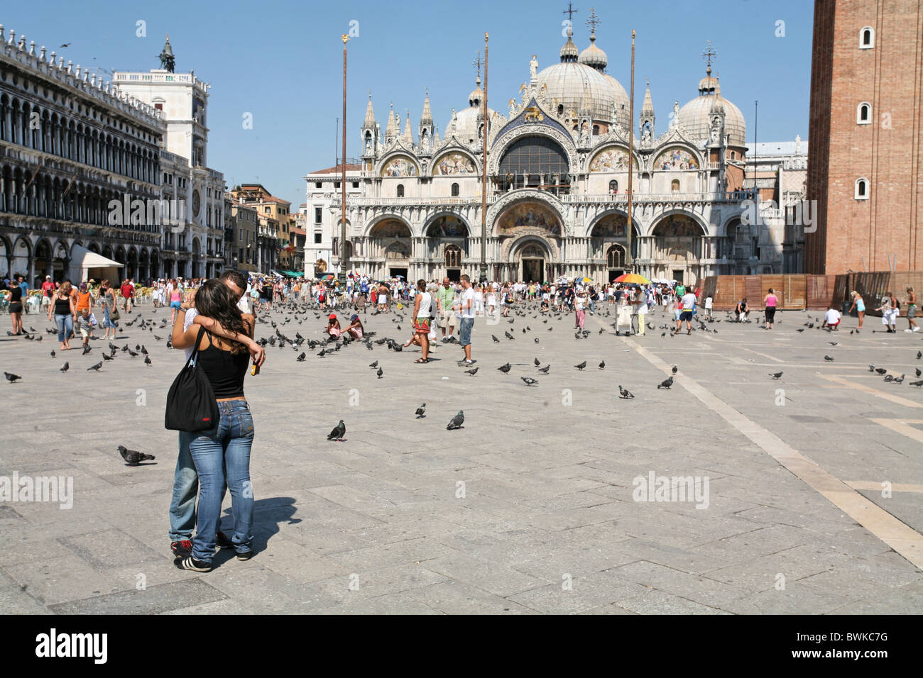 Venice Italy Europe Marco place Couple lovers pigeons people tourists Basilica di San Marco Marco cathedral - Stock Image
