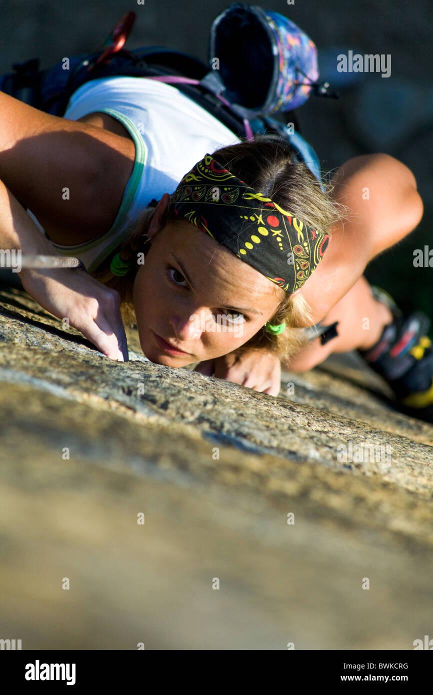 Vertical image of girl training rock-climbing - Stock Image