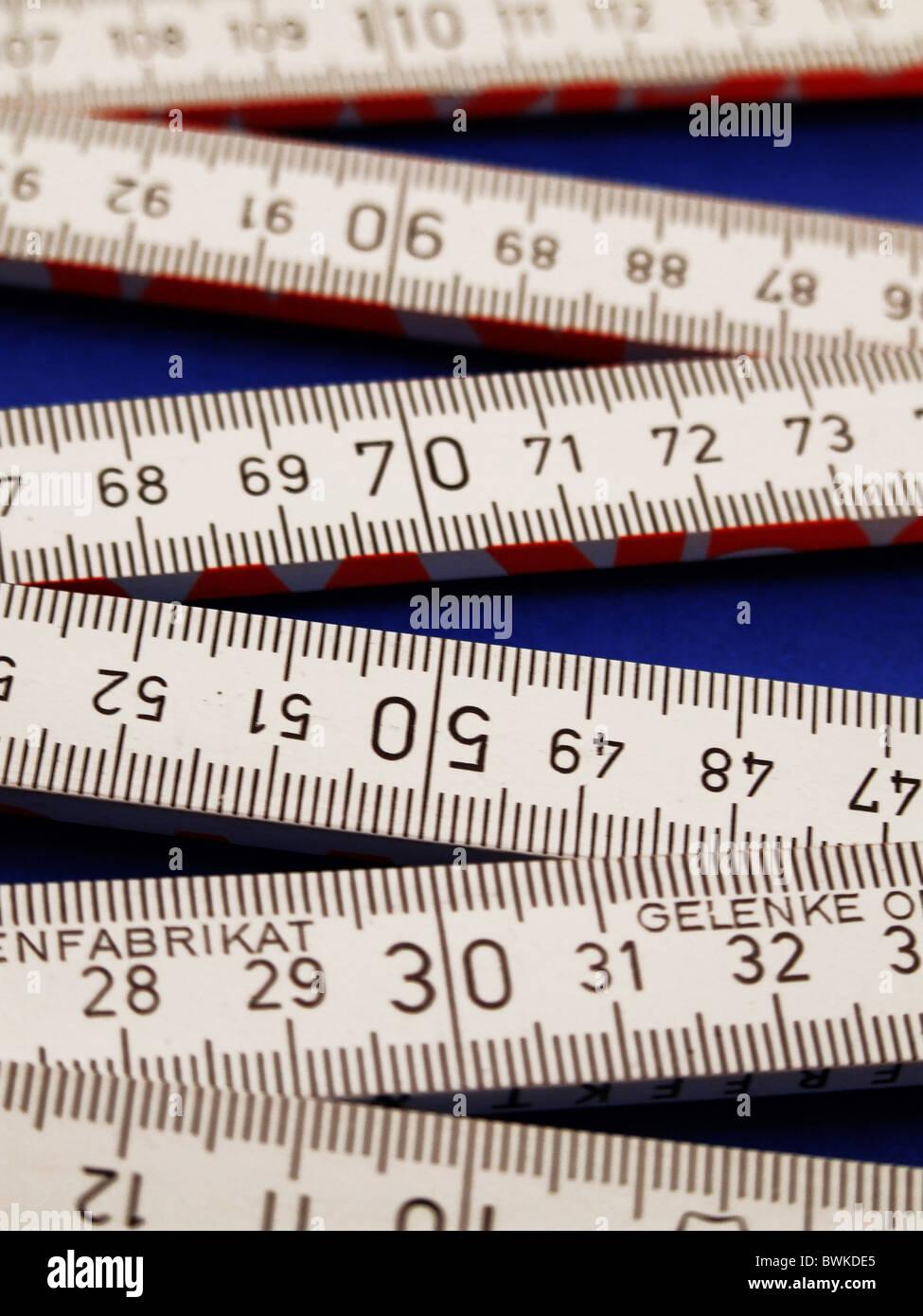 folding rule graduation meter stick limb graduation detail scale measuring measure - Stock Image