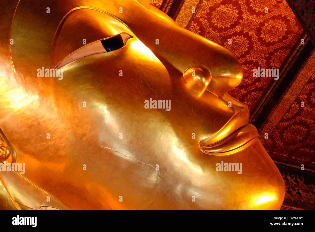 Asia Bangkok Buddha Buddha statue Buddhism Buddhist Buddhist figure face nonviolence belief confidence Gol - Stock Image