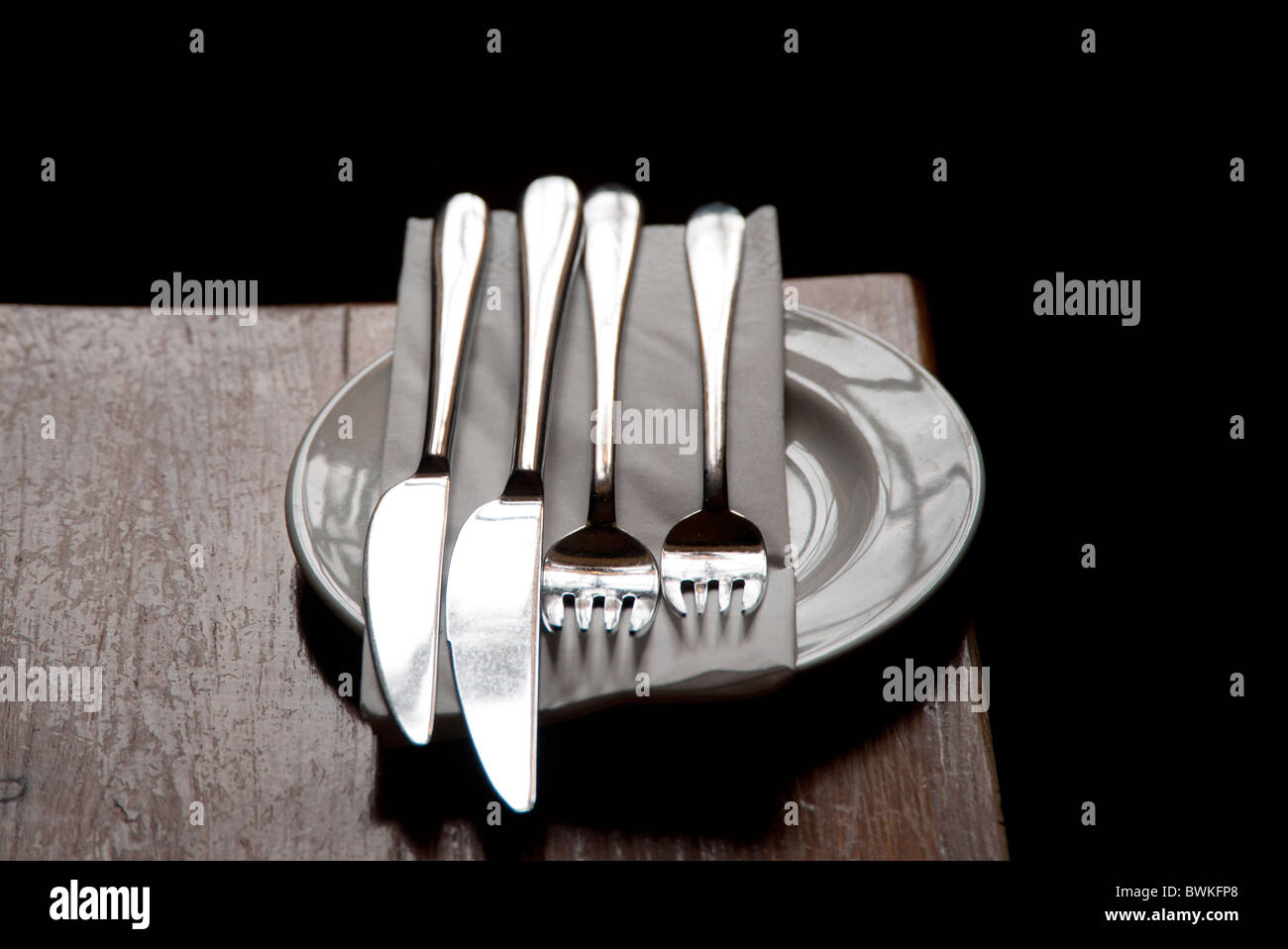 plate knifes and forks - Stock Image