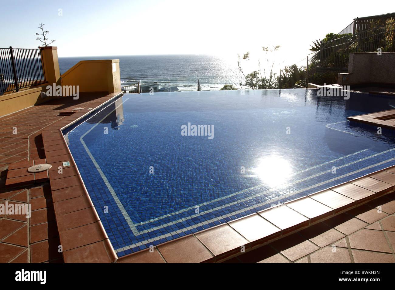 Australia, Queensland, Gold Coast, Magic Mountain Resort Pool and Pacific Ocean - Stock Image