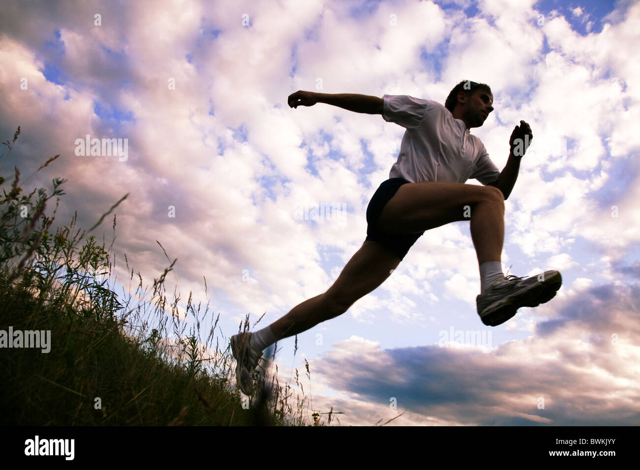 View from below of sportsman doing exercise - Stock Image