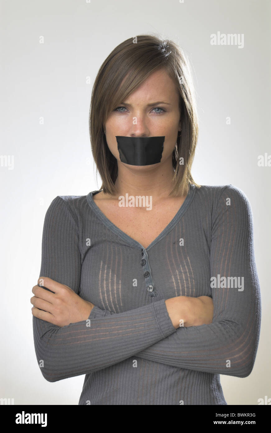 woman Inside portrait Gagged toggle plaster mouth adhesive tape Silent Sullenly protest remonstrance studi - Stock Image