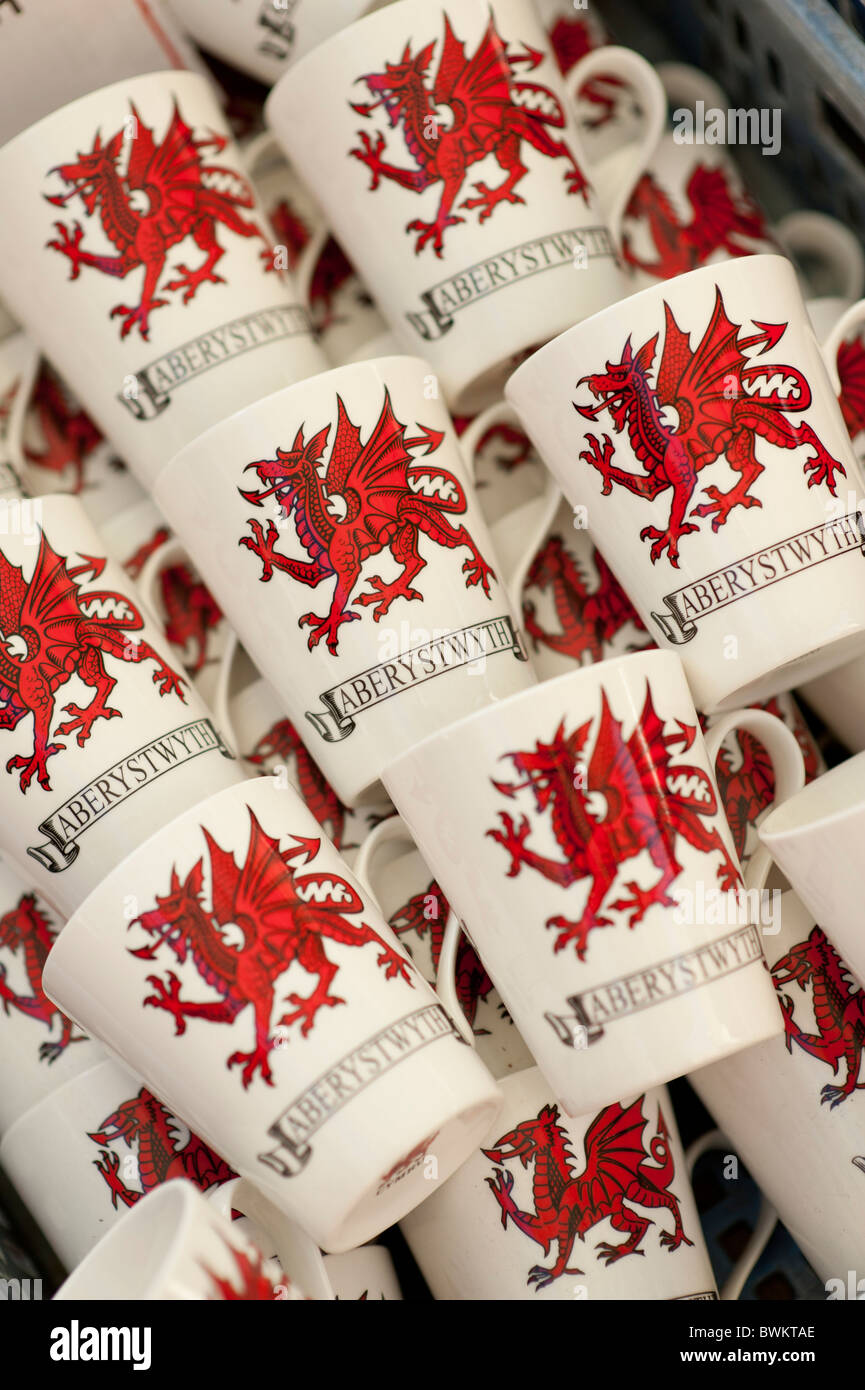 wales welsh souvenir mugs on sale on a market stall - Stock Image