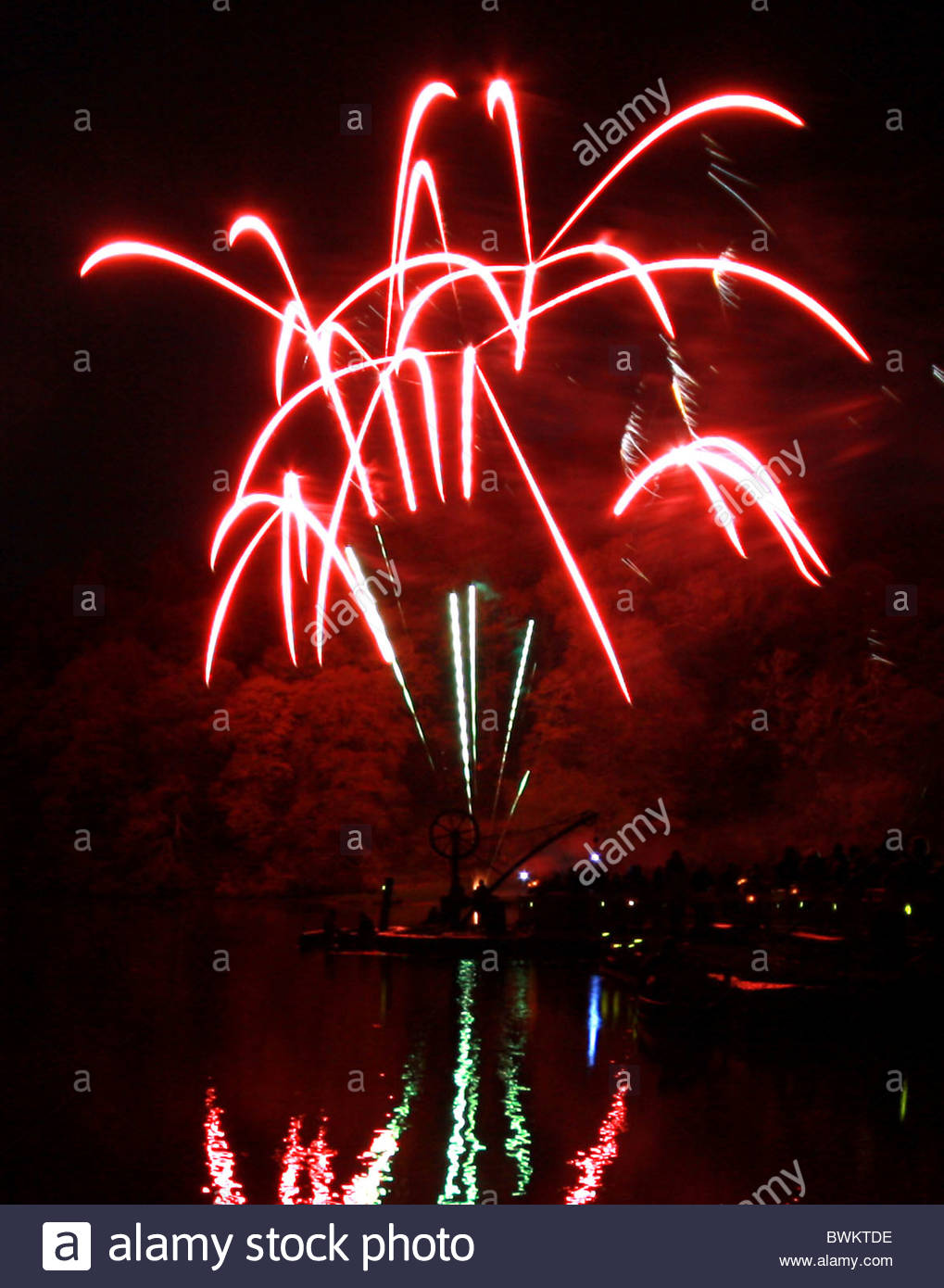 """Fireworks are reflected in the creek at Cotehele, Cornwall U.K. during the """"River of Light"""" event. - Stock Image"""