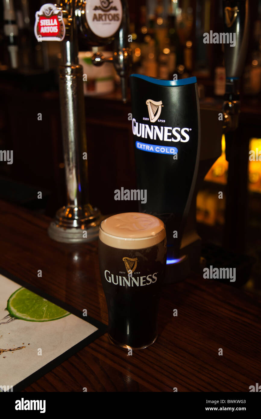 Fresh Draught beer pint of Guiness just served at pub - Stock Image