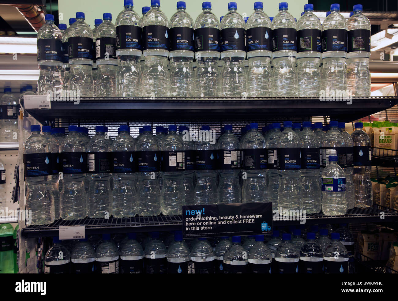 Bottled water water bottles drinking water in shop - Stock Image