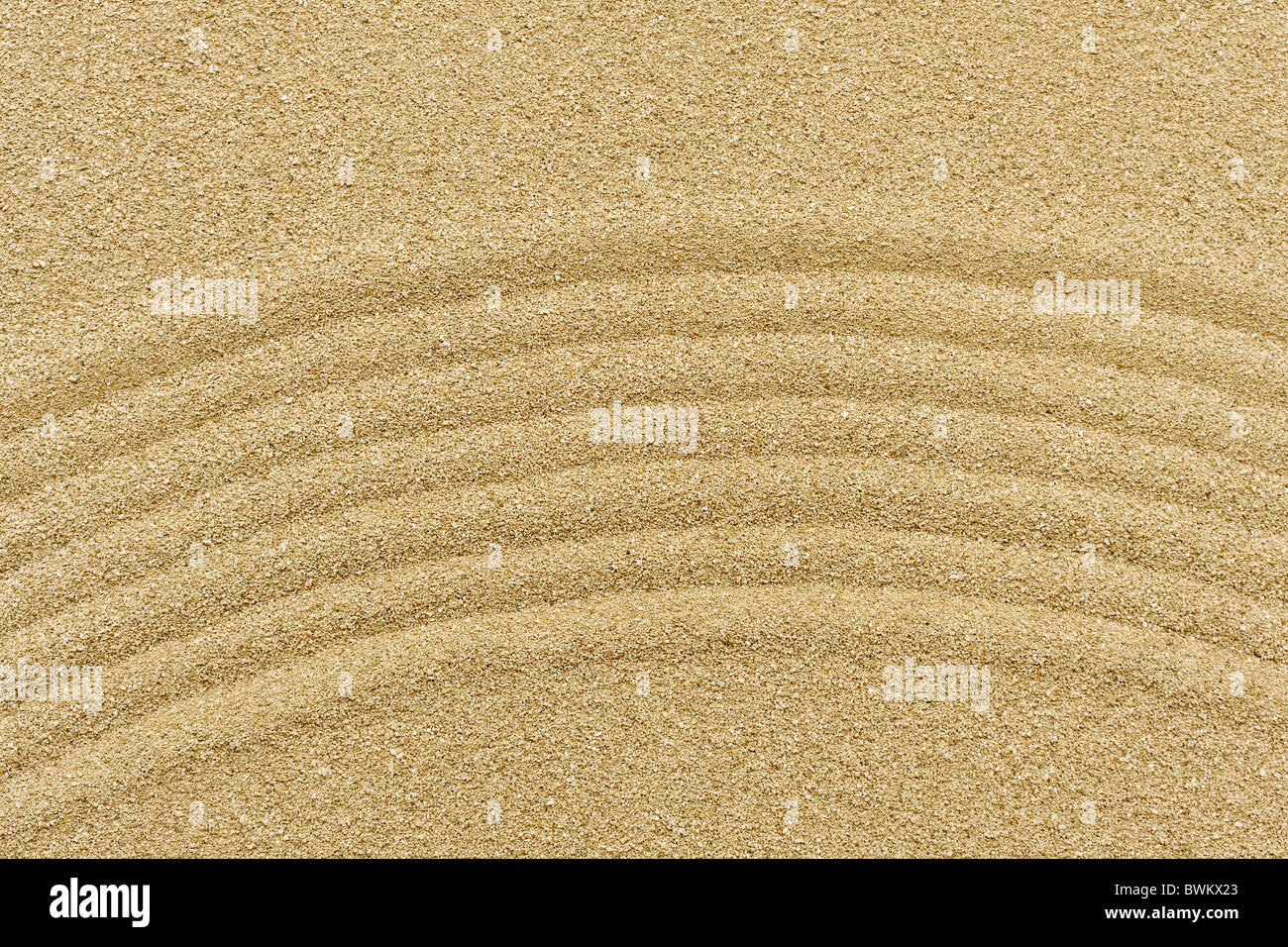 raked sand - zen rock garden - japan zen spirit inspired arrangement - Stock Image