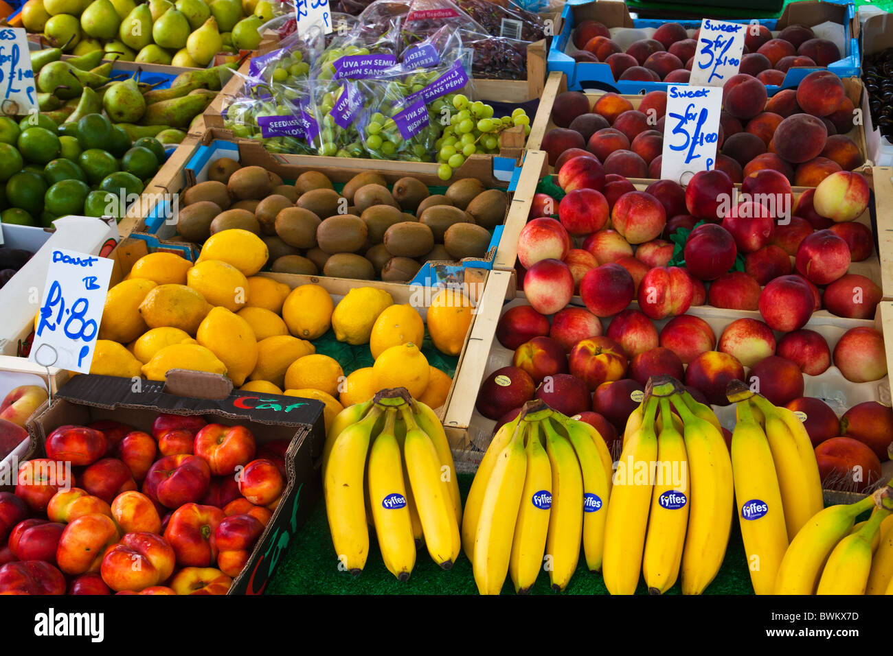 Selection of fresh fruits and vegetables at at fruits and vegetable stall at Portobello Road market - Stock Image