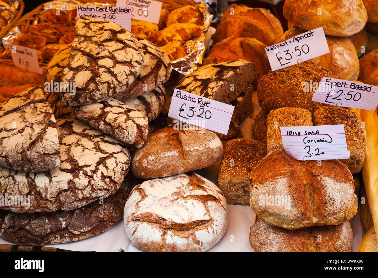 Selection of locally made breads whole grain bread at Portobello Road market - Stock Image