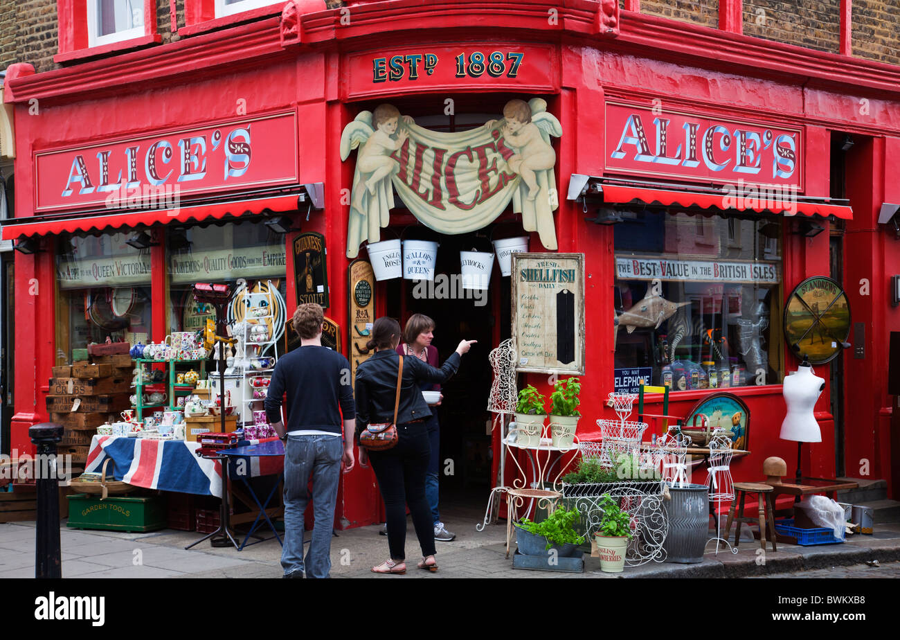 Customers tourists  outside iconic shop Alice's Portobello Road on a summer day - Stock Image