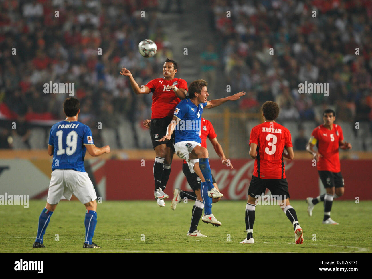 Hosam Hassan of Egypt (l) and Umberto Eusepi of Italy (r) jump for a header during a 2009 FIFA U-20 World Cup Group - Stock Image