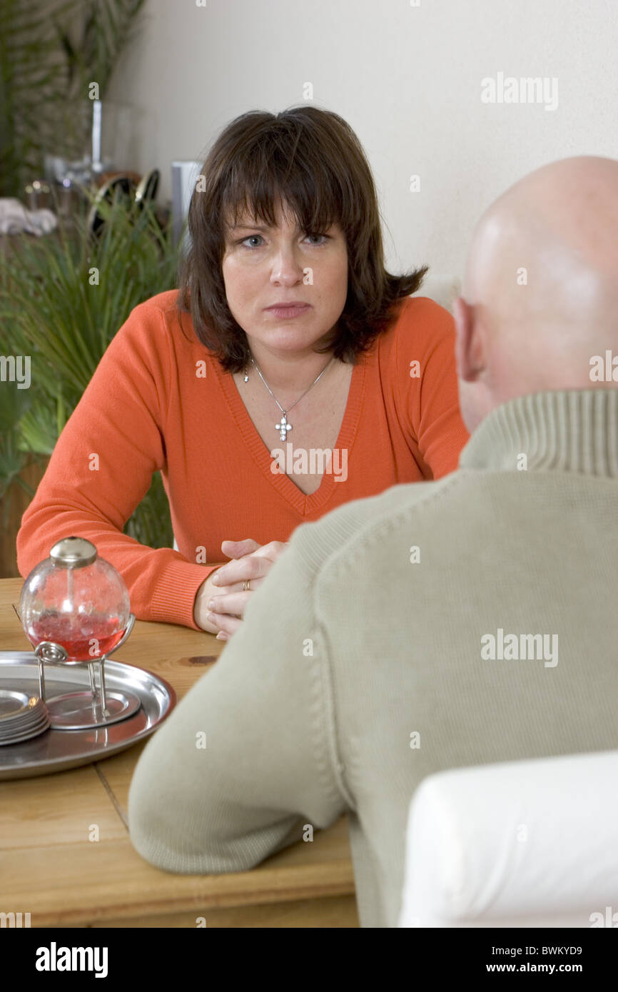 Couples and marital problems couple talking - Stock Image