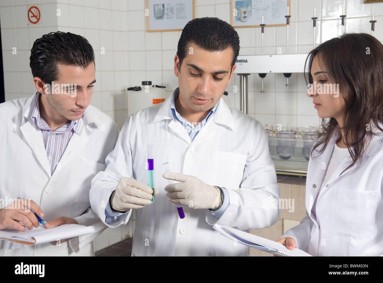 University instructor teaching students inside laboratory Beirut Arab university Lebanon Middle East Asia - Stock Image