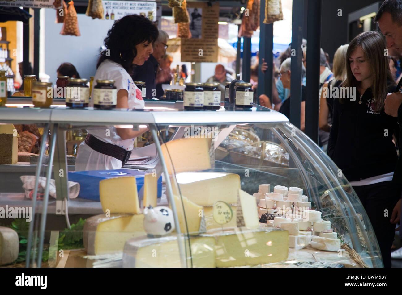 Cheese seller, Sarlat market, Dordogne, France - Stock Image