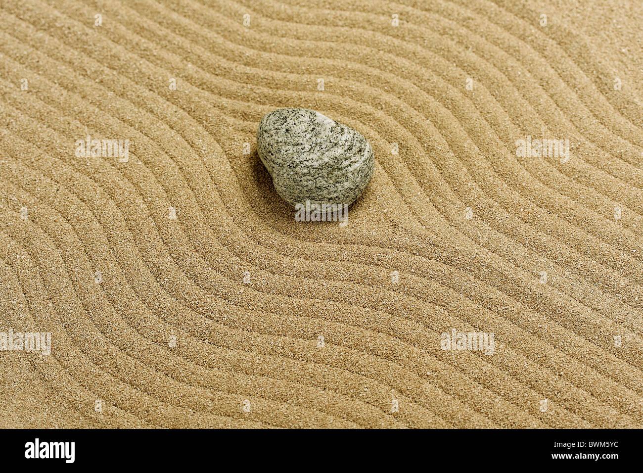 raked sand - zen rock garden - japan zen spirit inspired arrangement - Stock Image
