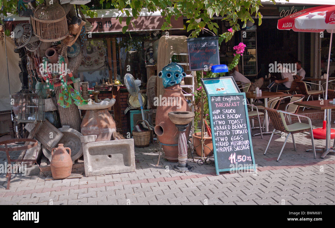 Junkshop next door to a restaurant in Gocek Turkeyj - Stock Image