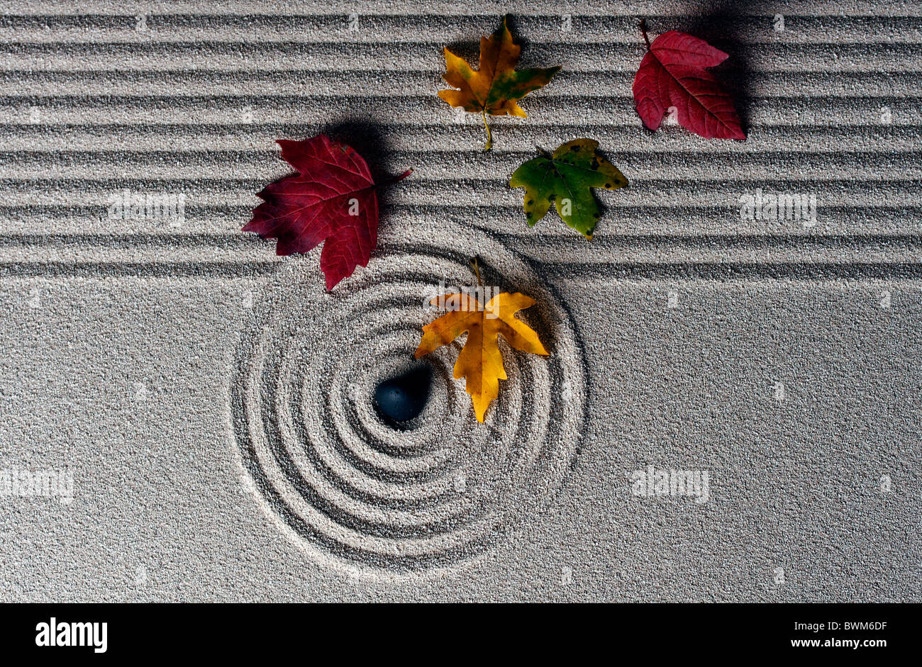 raked sand - zen rock garden - japan zen spirit inspired arrangement Stock Photo