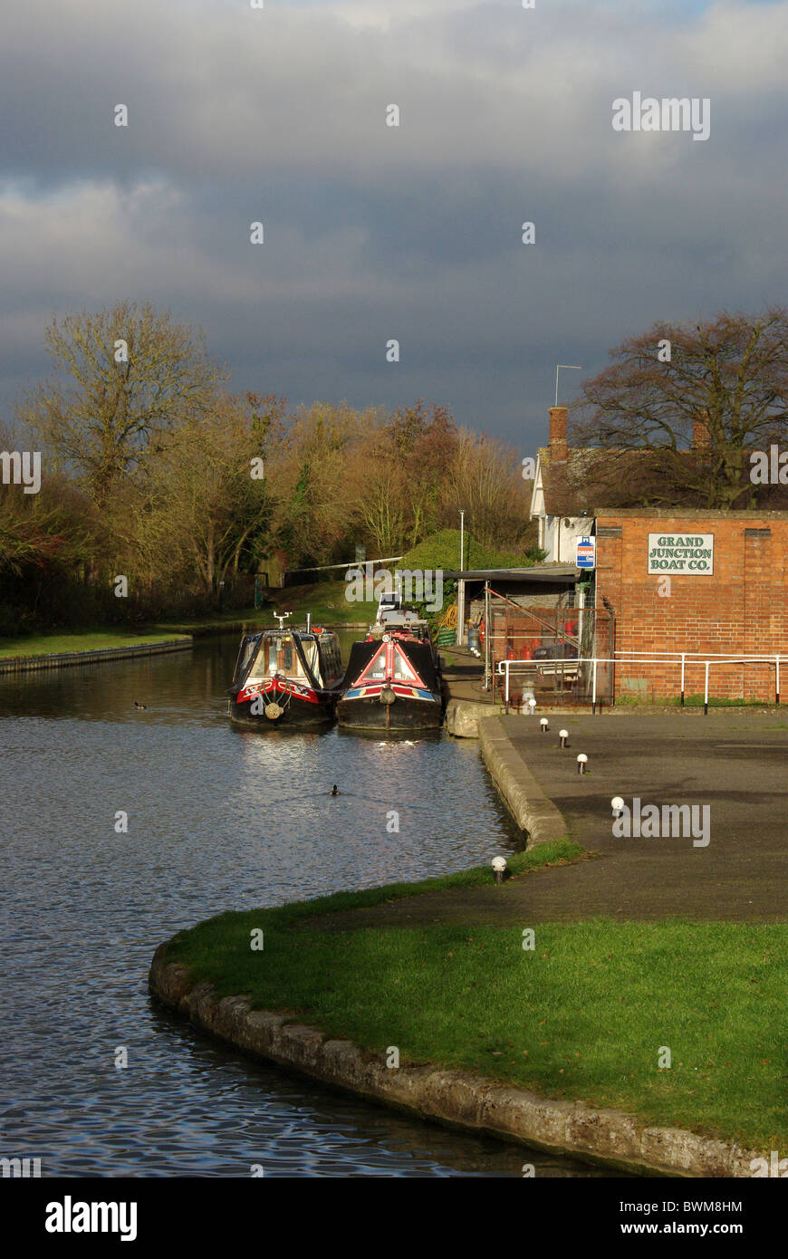 Two traditional narrowboats moored on the Grand Union Canal at Blisworth Arm, Northamptonshire, UK - Stock Image