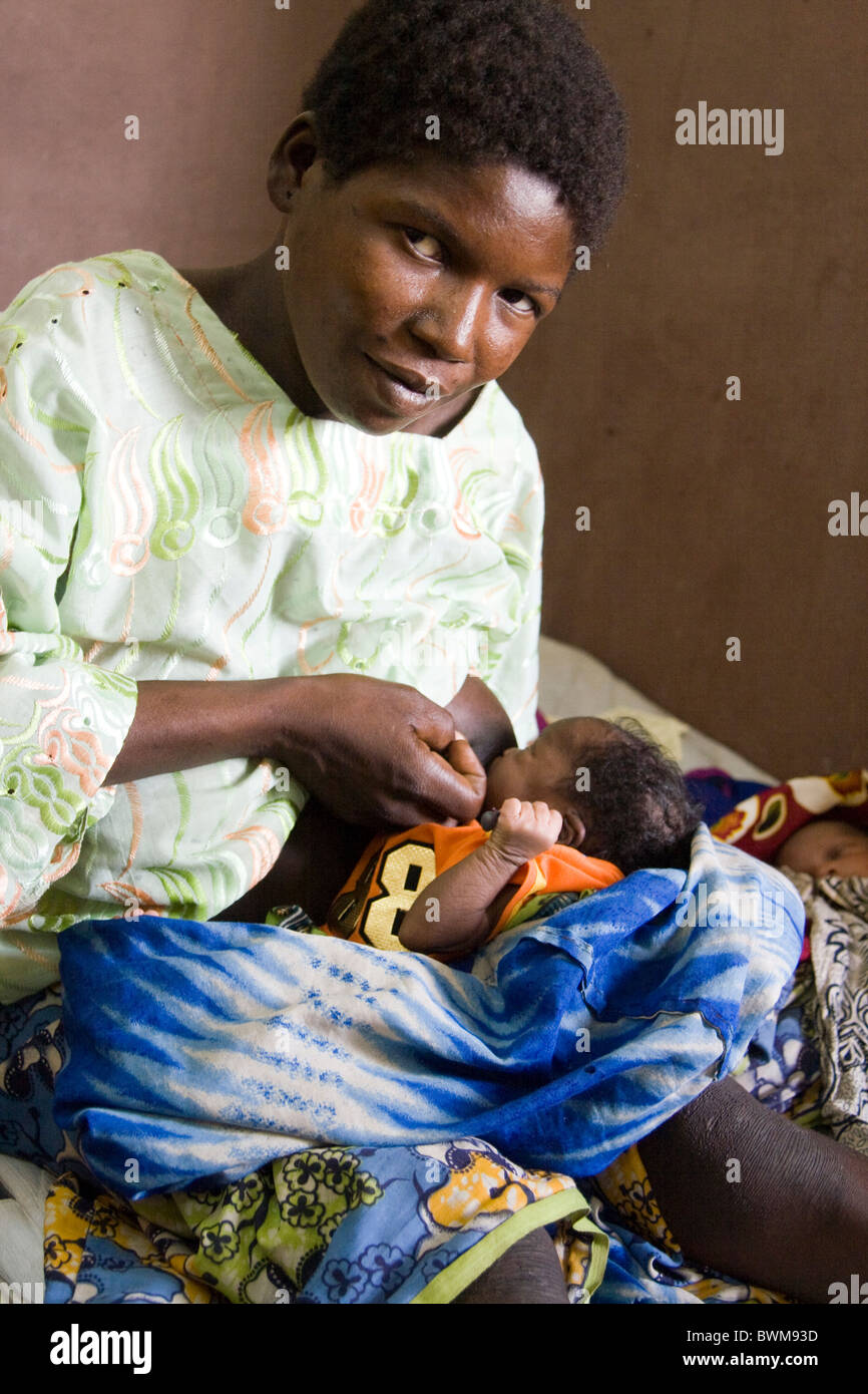A mother breastfeeding her twin babies in paoua hospital msf central african republic
