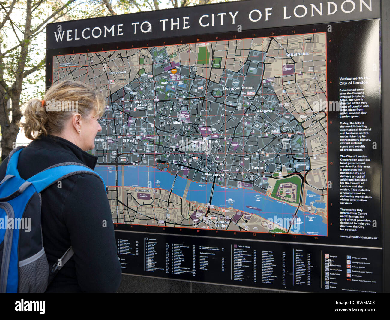 tourist to london looking for directions on the city of london street map near to st pauls cathedral