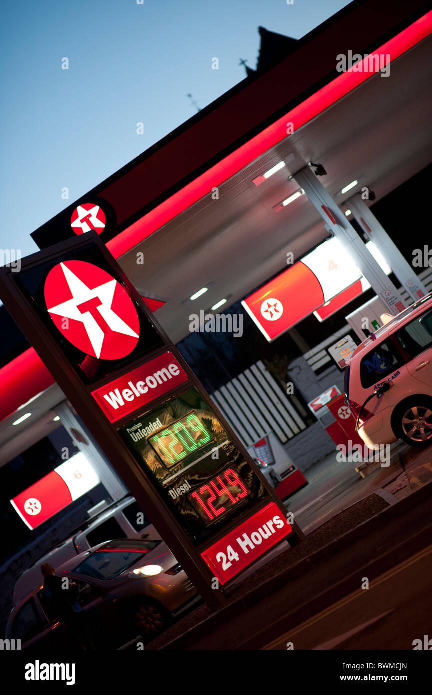 A Texaco petrol station garage at night, Aberystwyth Wales UK - Stock Image