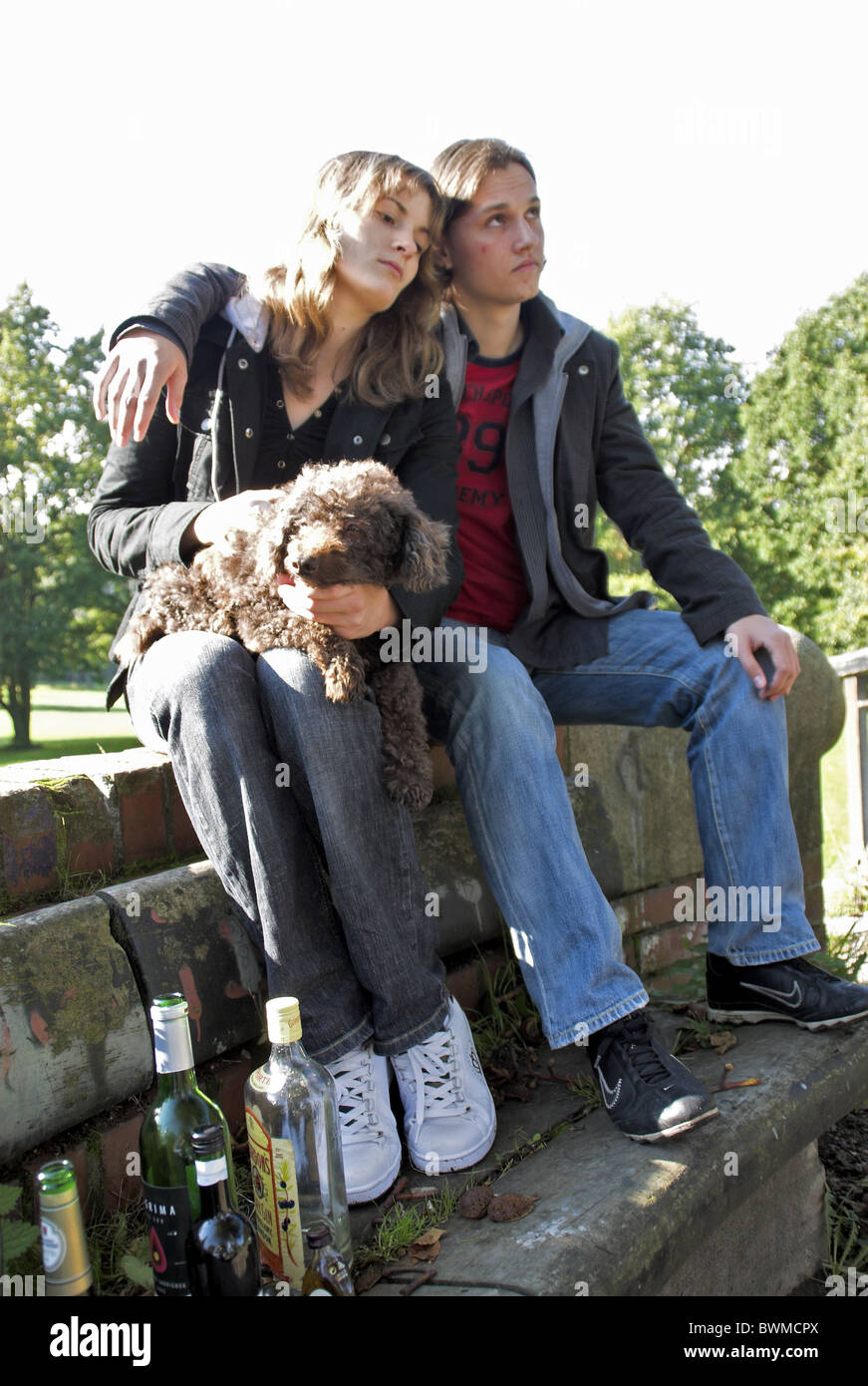 Boozer alcoholic Jobless unemployed persons hopelessly Sad bored Couple outside two persons woman man you - Stock Image