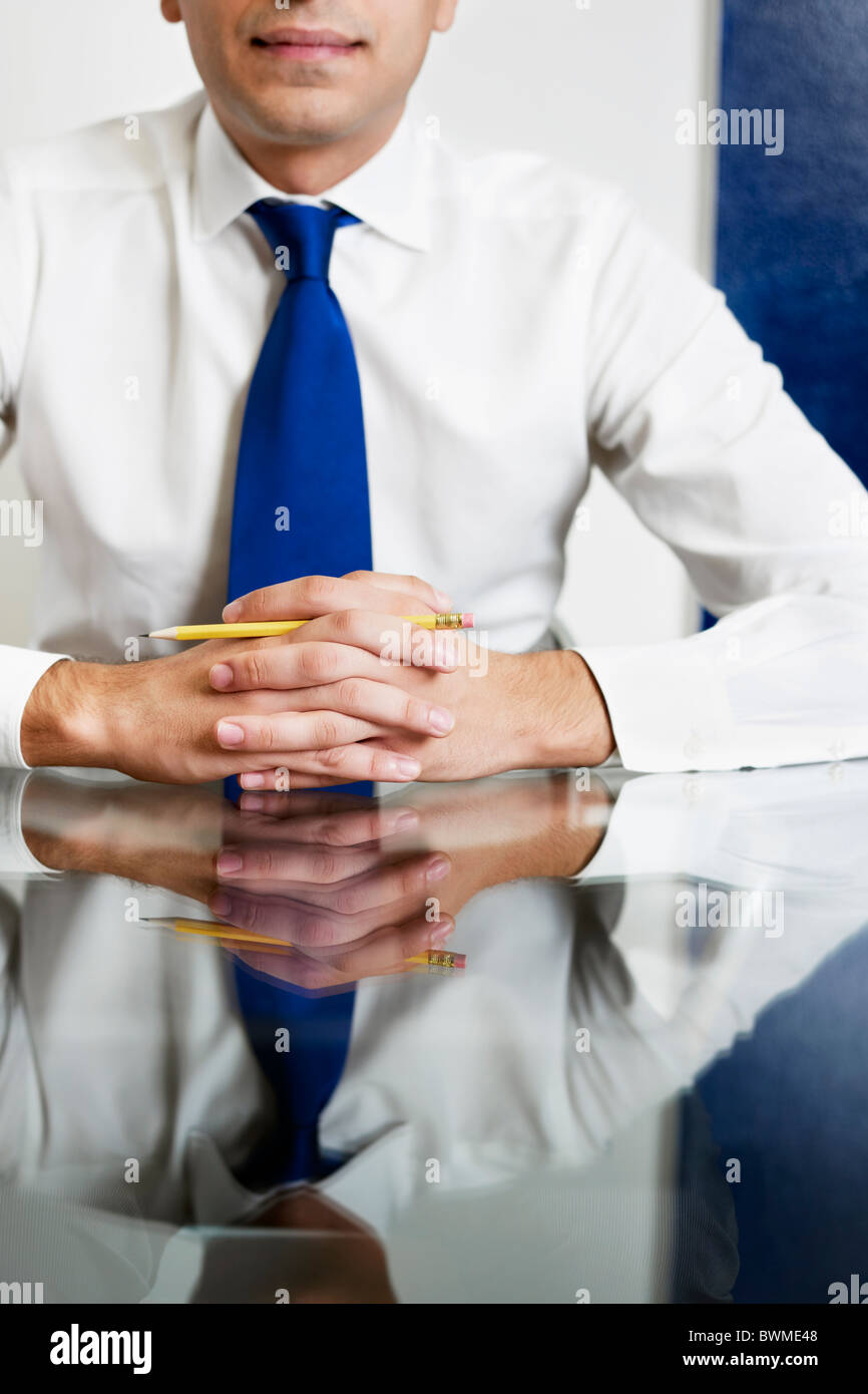 cropped view of businessman with hands clasped. Vertical shape, front view - Stock Image