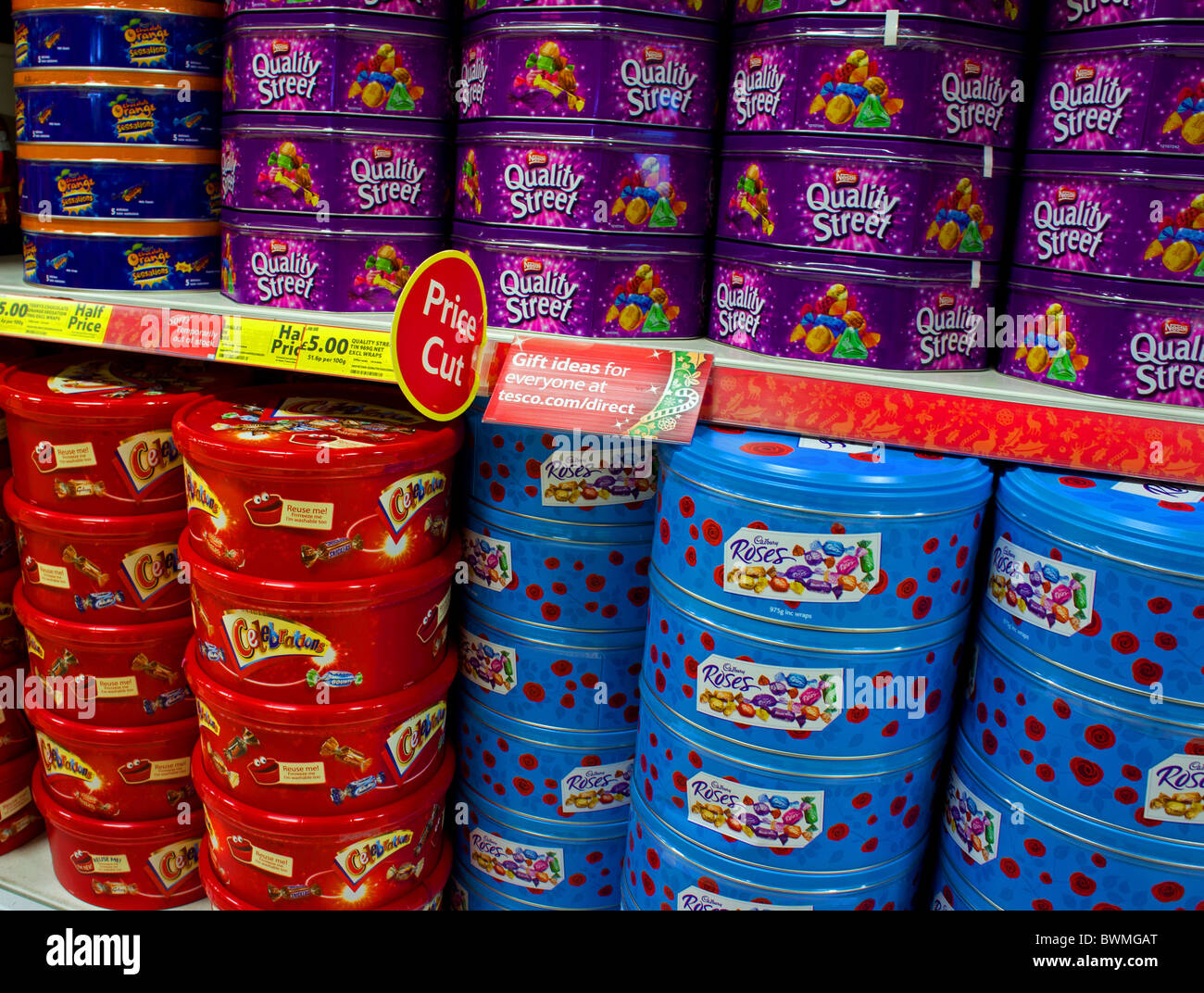 tins of christmas sweets on  supermarket shelves - Stock Image