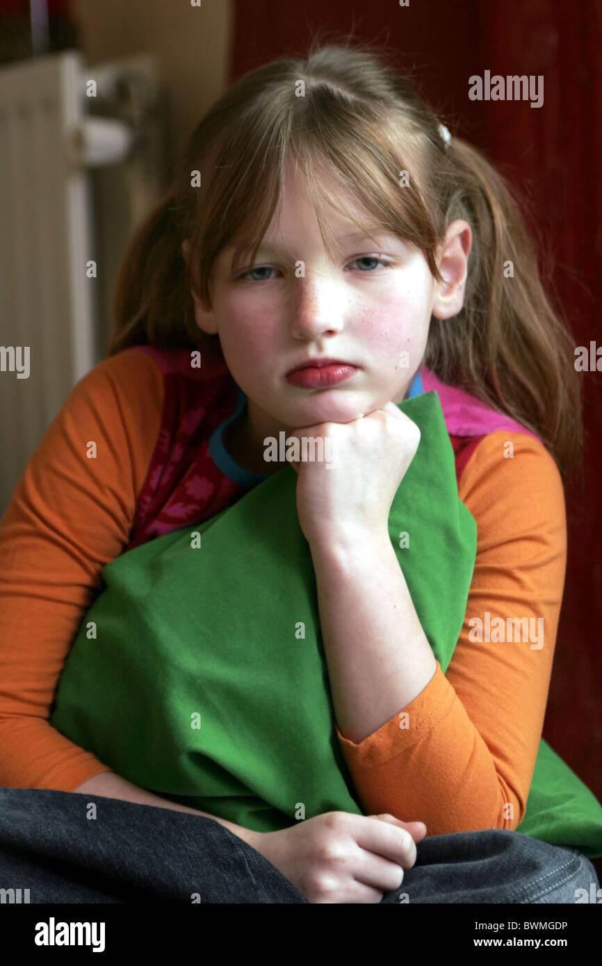 Unhappy child being grounded - Stock Image