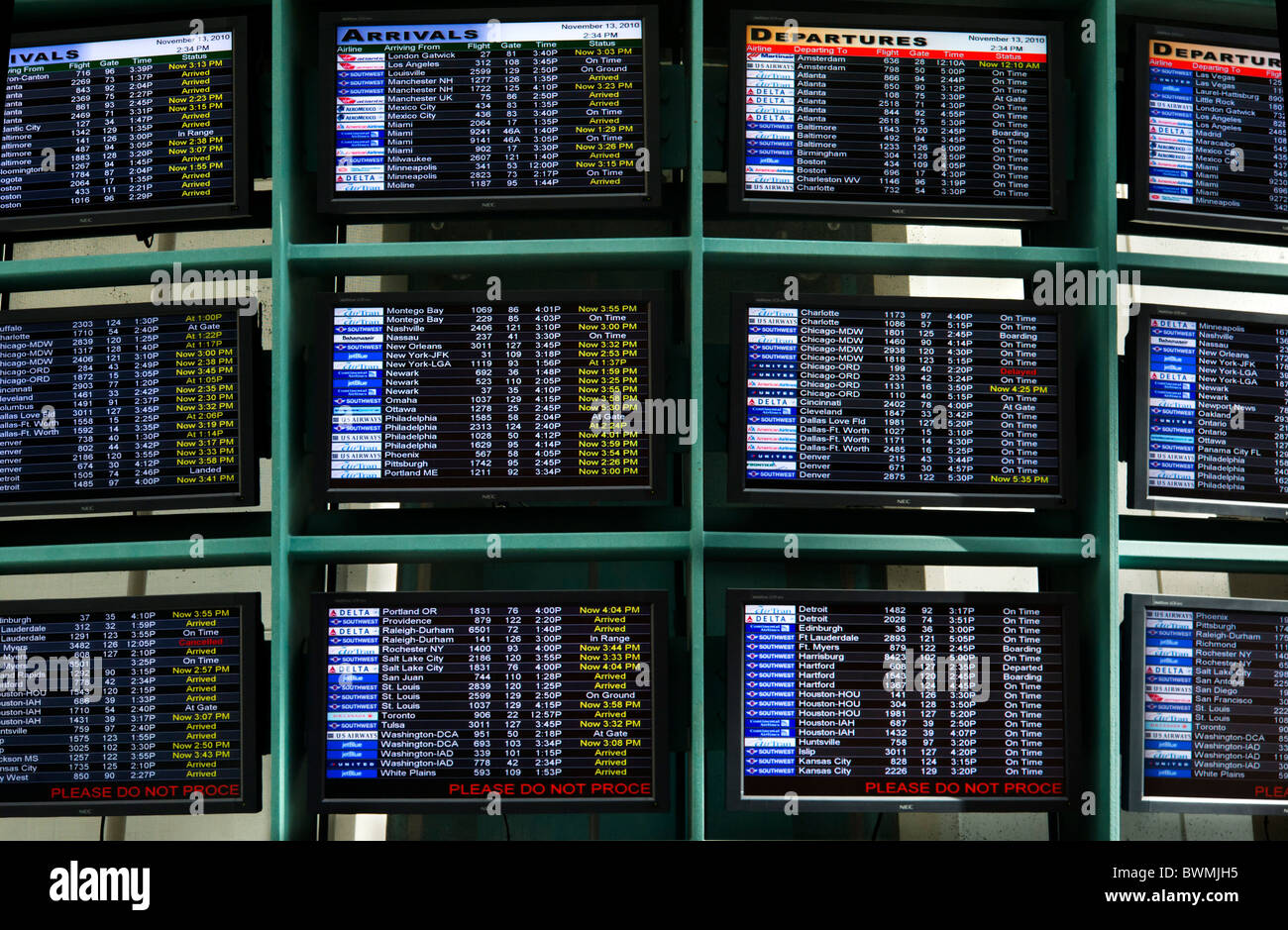 Flight Arrivals and Departures boards at Orlando International Airport, Florida, USA - Stock Image