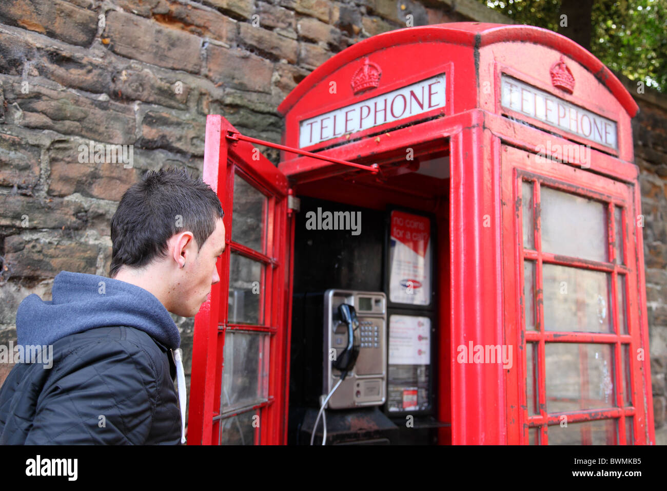 A red telephone box in a U.K. city. - Stock Image