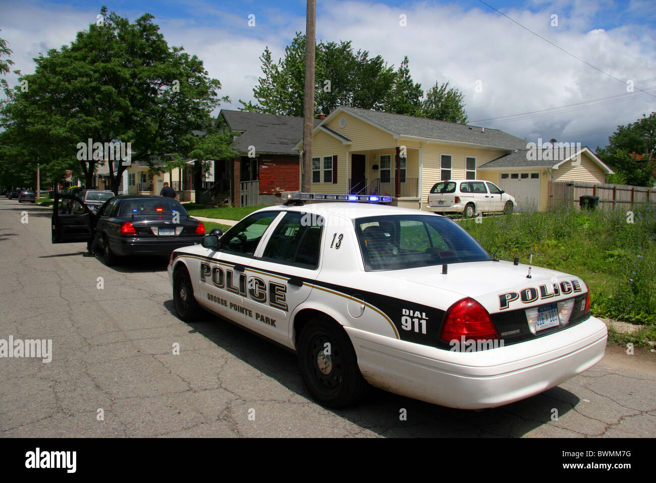 Grosse Pointe Park police squad car in a Detroit neighbourhood. - Stock Image