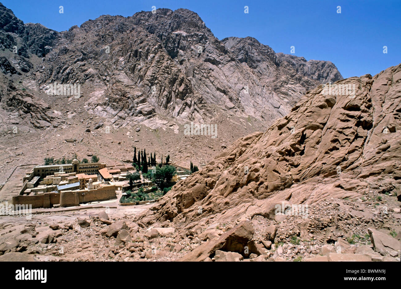 Rocky cliffs surrounding the buildings of Saint Catherine's Monastery a UNESCO world heritage site, Mount Sinai, - Stock Image
