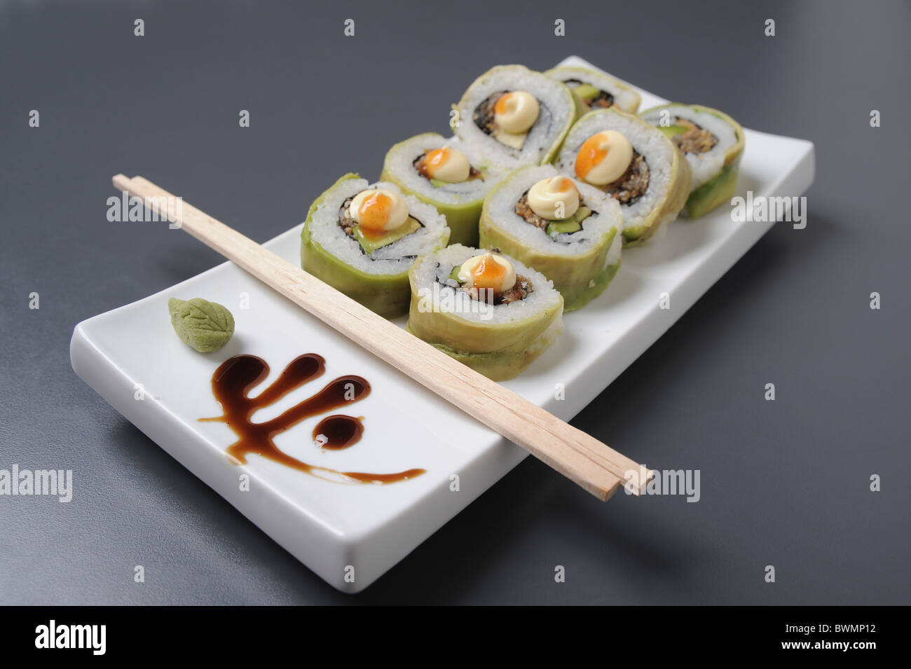 Sushi on a platter with chopsticks  - Stock Image