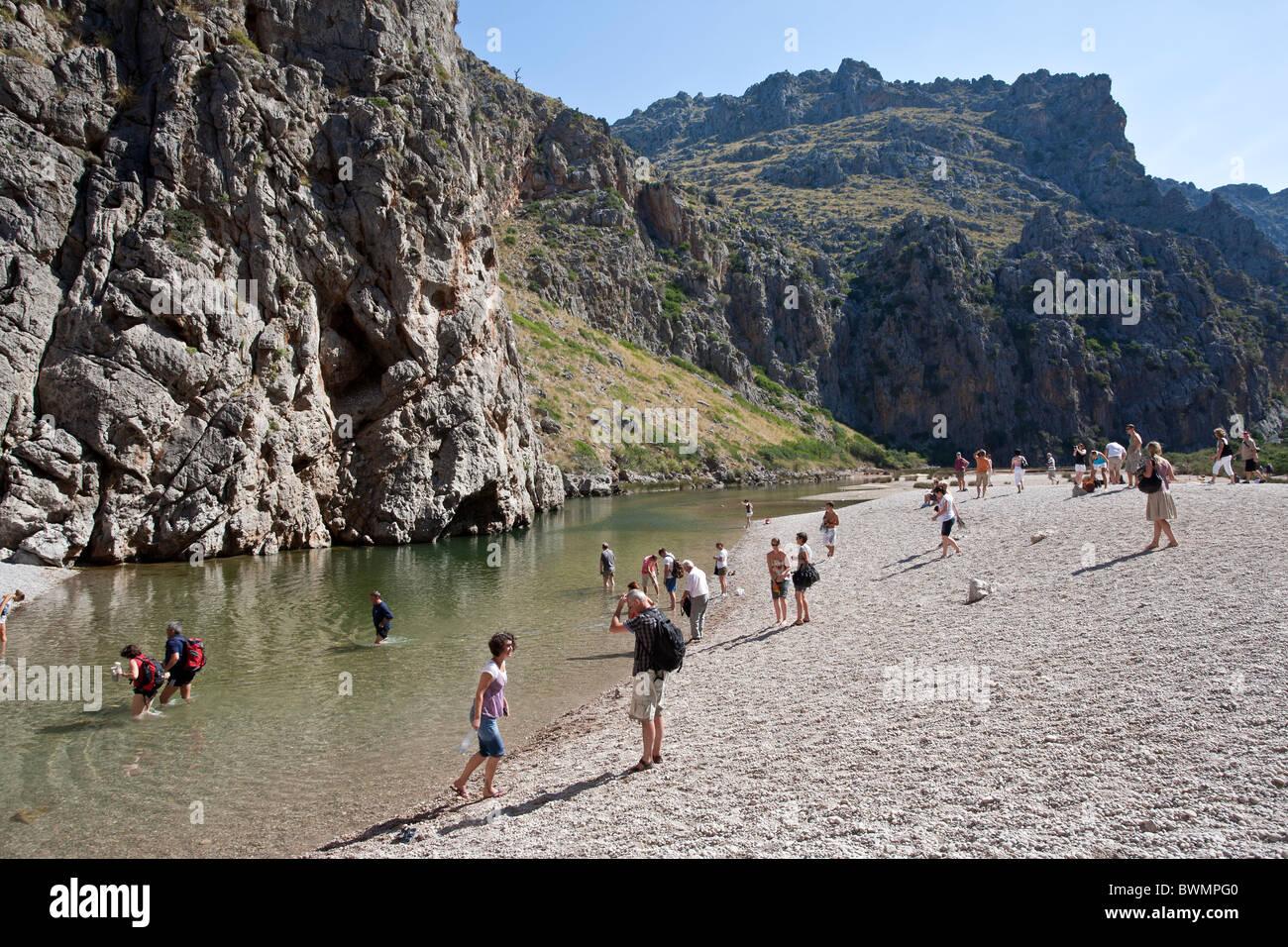 Tourists visiting Torrent de Pareis. Sa Calobra. Mallorca Island. Spain - Stock Image