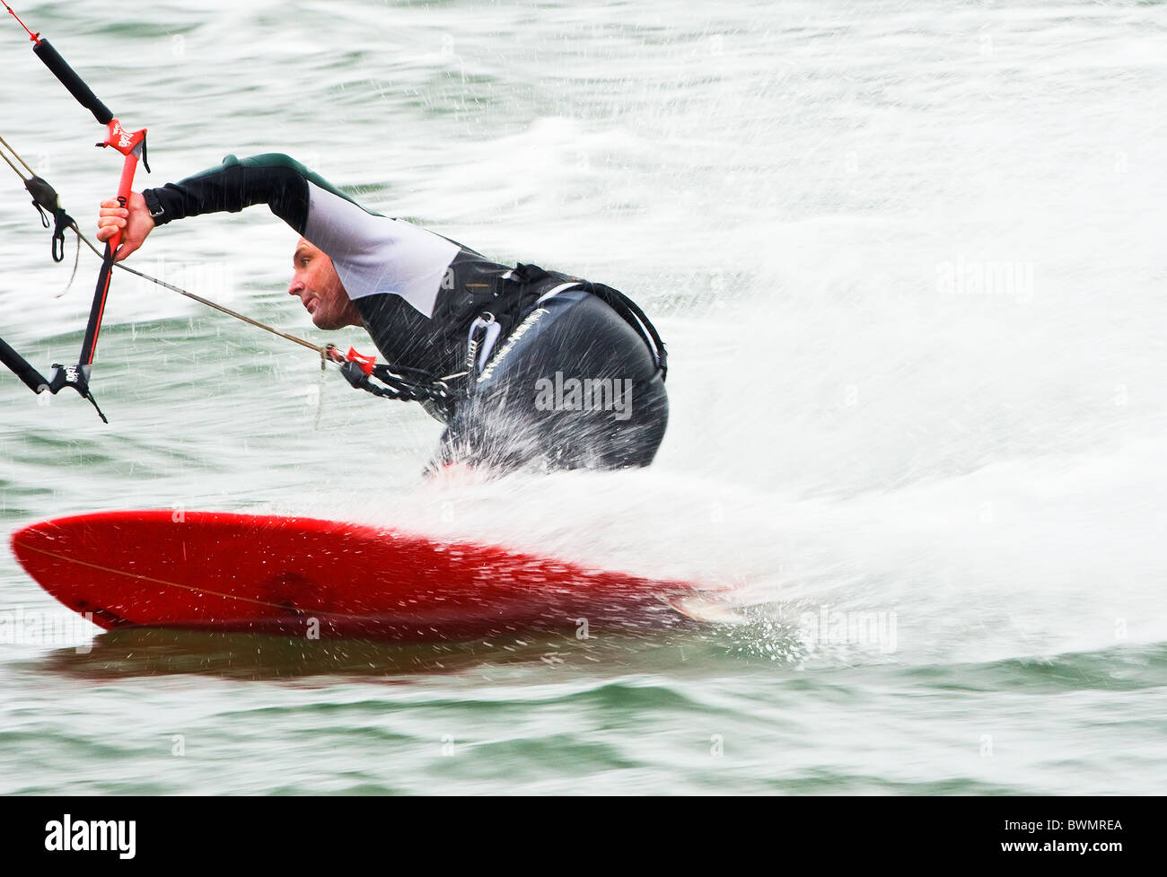 Kitesurfing on the river Exe estuary, Exmouth, Devon, England, UK - Stock Image