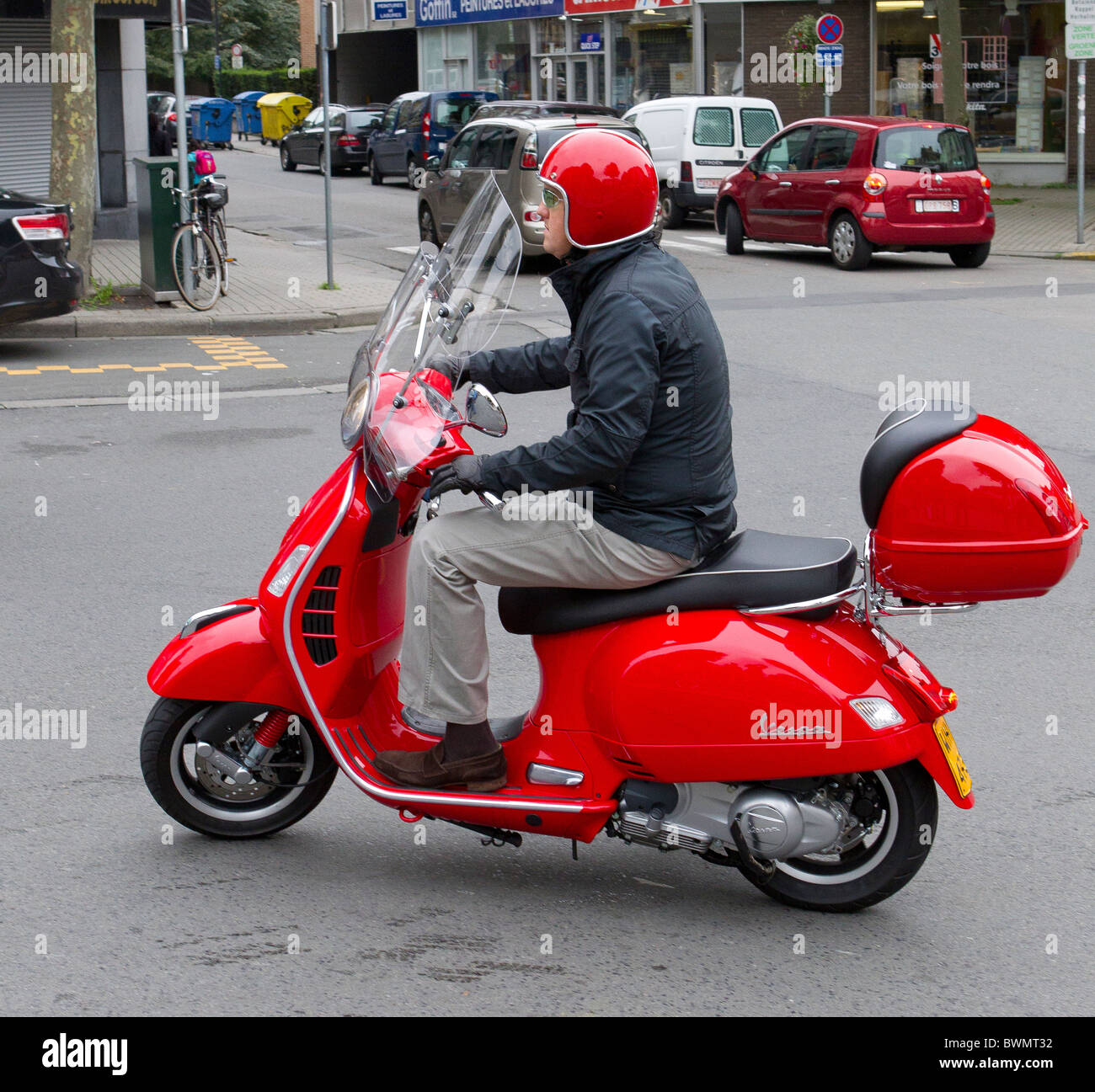 red vespa rider helmet street scooter Stock Photo: 33034710