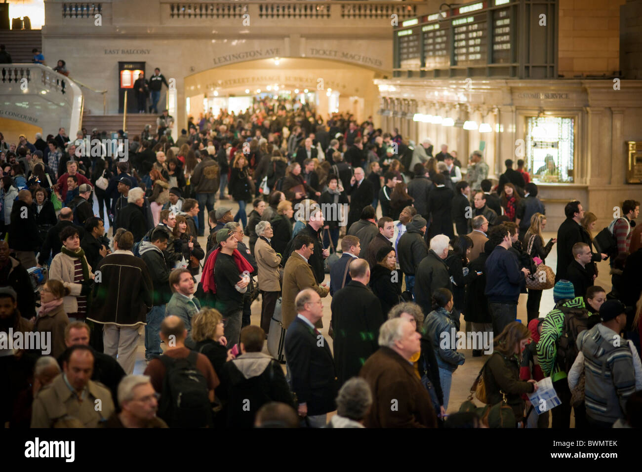 Travelers crowd Grand Central Terminal in New York for the Thanksgiving weekend exodus - Stock Image