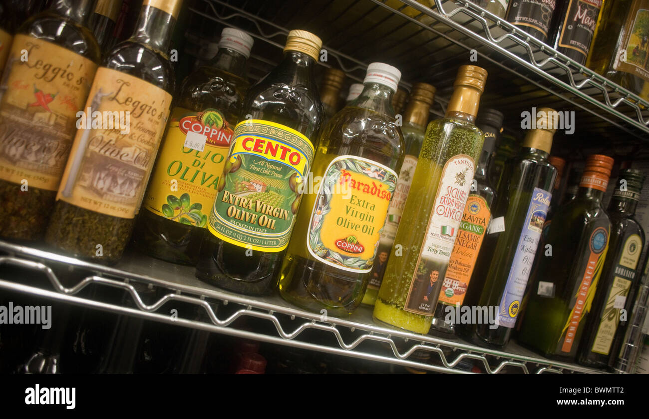 Bottles of imported olive oil are seen on a supermarket shelf on Thursday, November 23, 2010. (© Richard B. - Stock Image