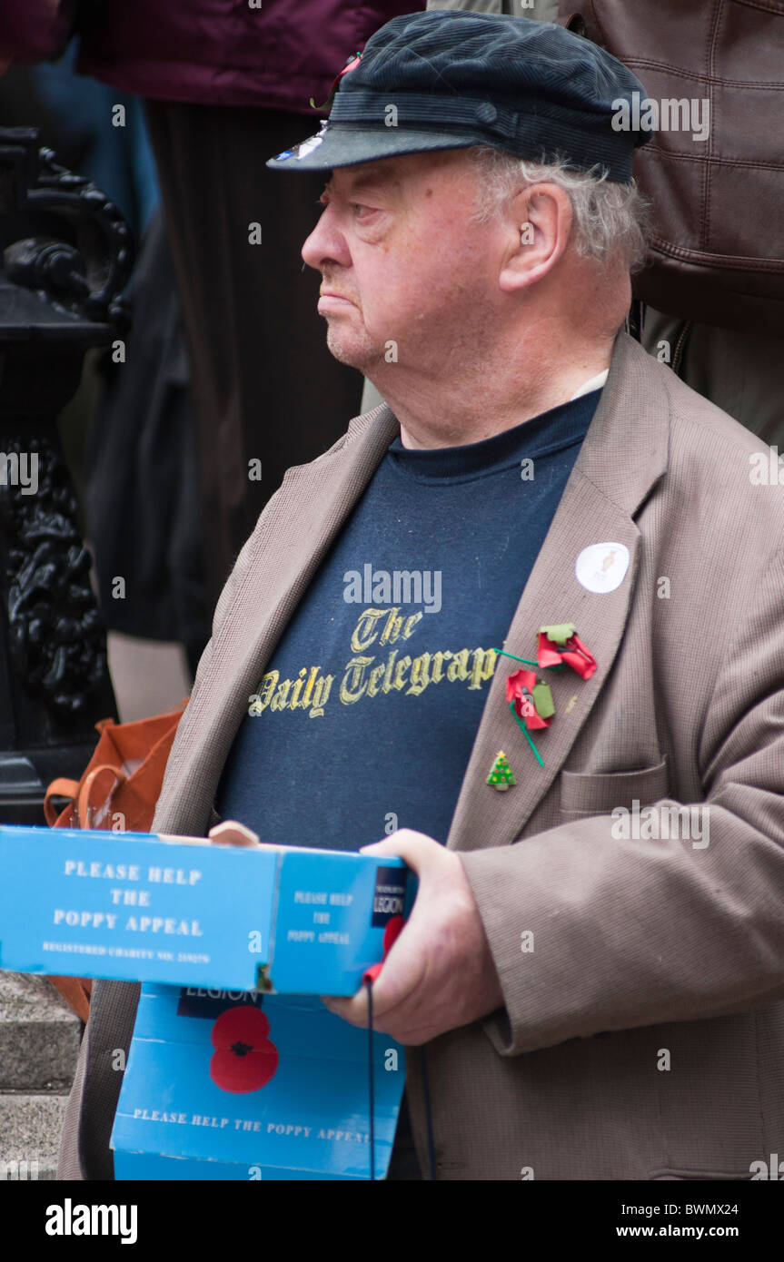 A downs syndrome man selling poppies for Remembrance day. London. UK - Stock Image